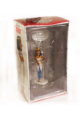 Statue: Cleopatra med skilt ('Qu'on serve L'apéritif aux crocodiles sacrés!'